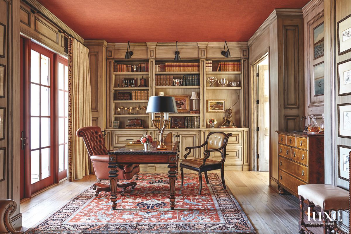 Orange Upholstered Library Ceiling with Rug and Antiques