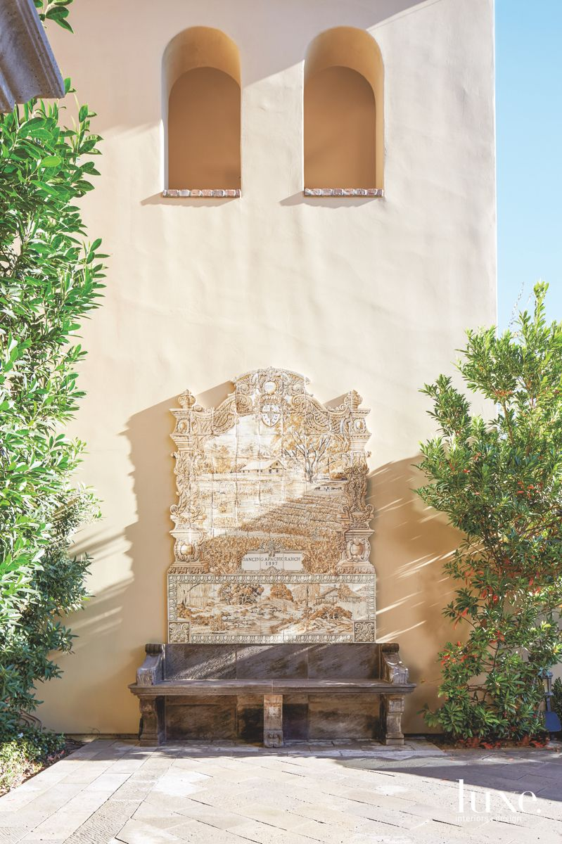 Custom Handcrafted Adobe Wall Art and Bench Exterior