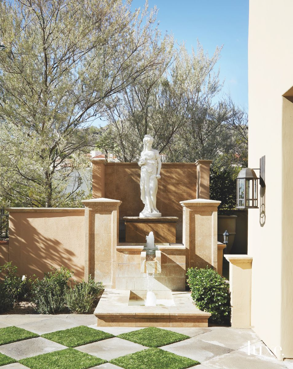 Checker Tile Exterior Floor with Statue and Mini Fountain