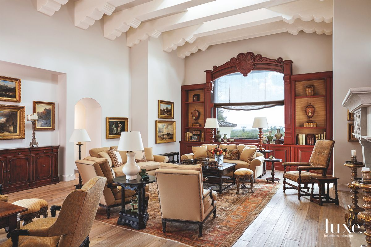 Family Crest Living Room with Crown Moulding, Artwork, and Antiques