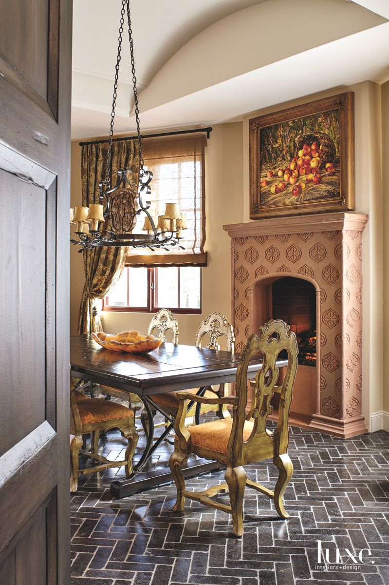 Terra Cotta Fireplace Dining Room with Custom Chandelier