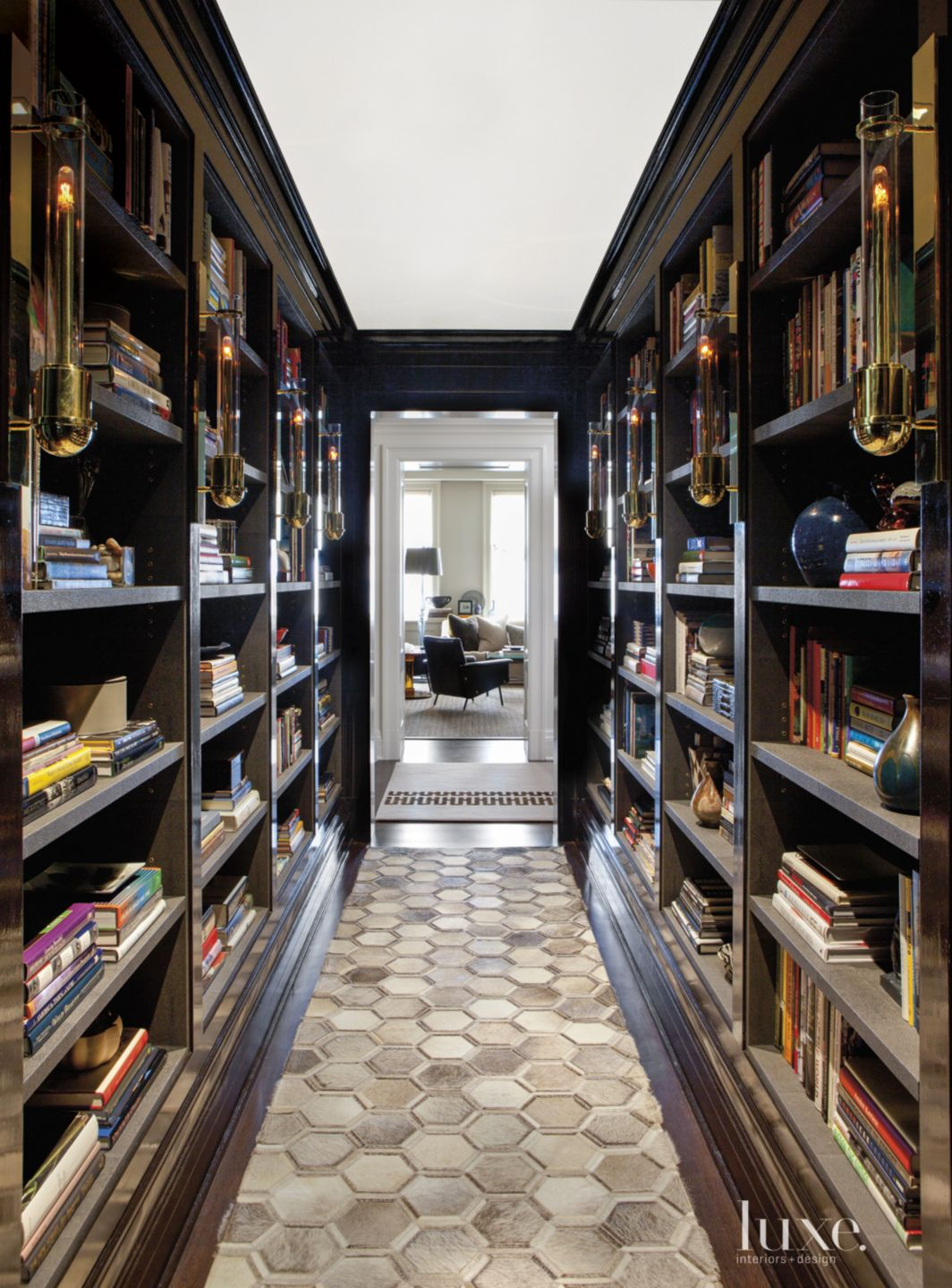 Eclectic Black Hallway with Bookshelves