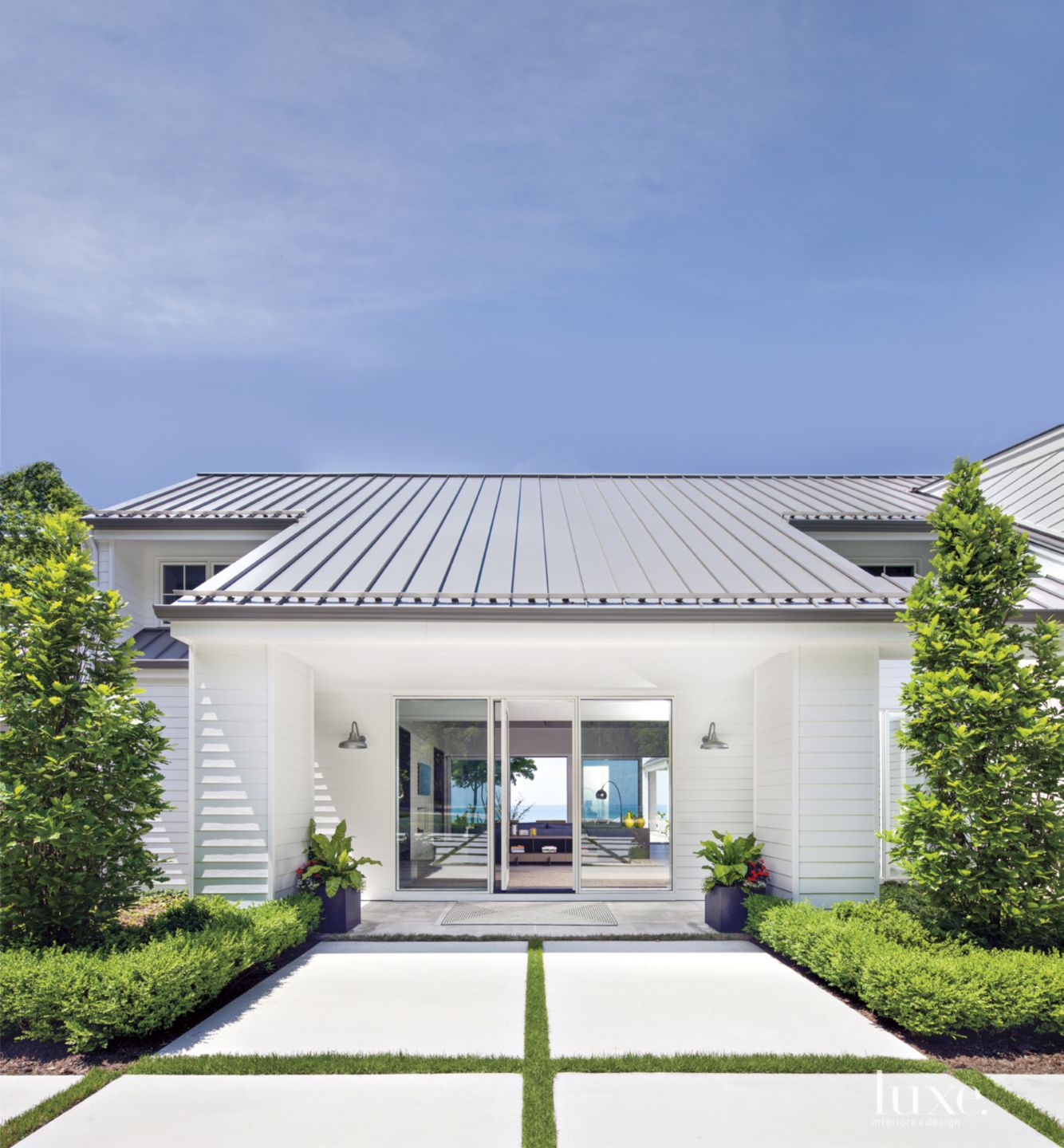 Contemporary White Front Elevation with Expansive Pavers