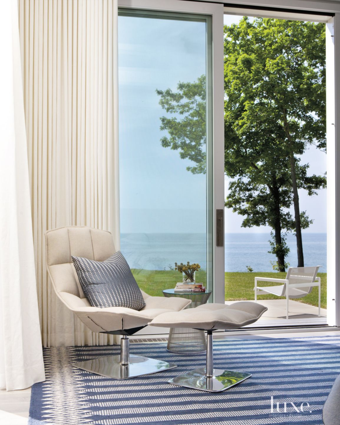 Contemporary White Sitting Area with Glass Sliding Door