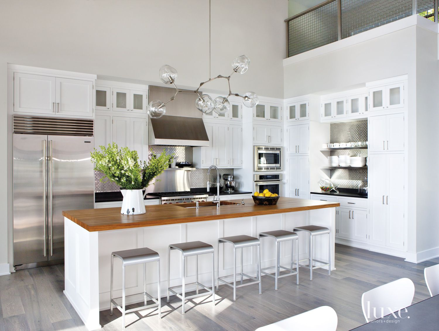 Contemporary White Kitchen with Stainless Steel Backsplash