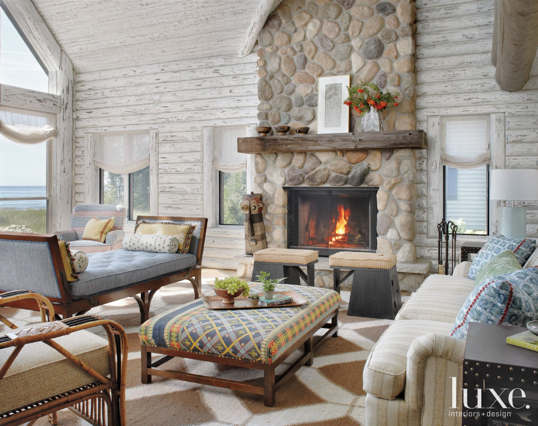 Country White Great Room with Stacked Stone Fireplace