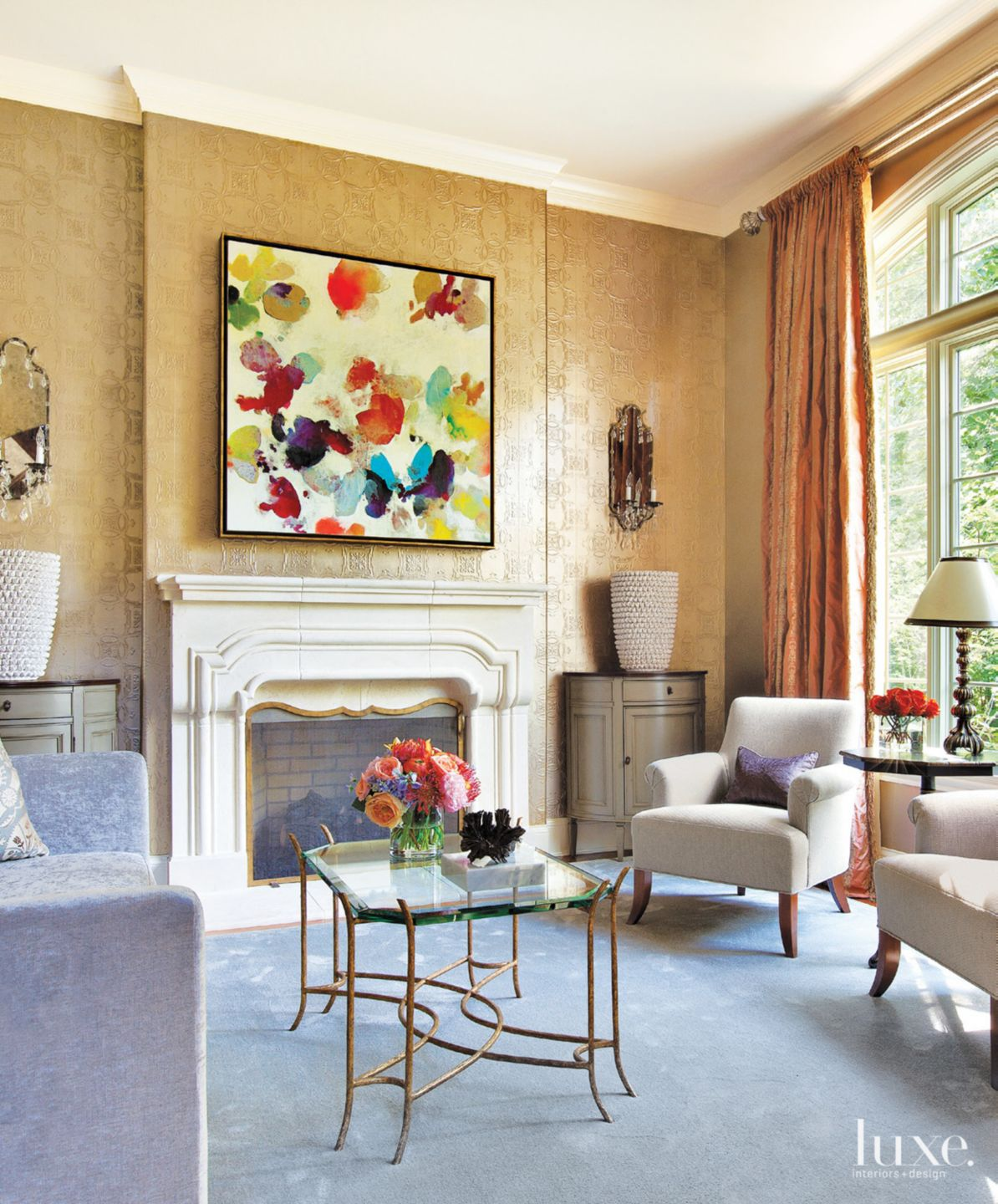 Eclectic Gold Living Room with Artwork over Fireplace
