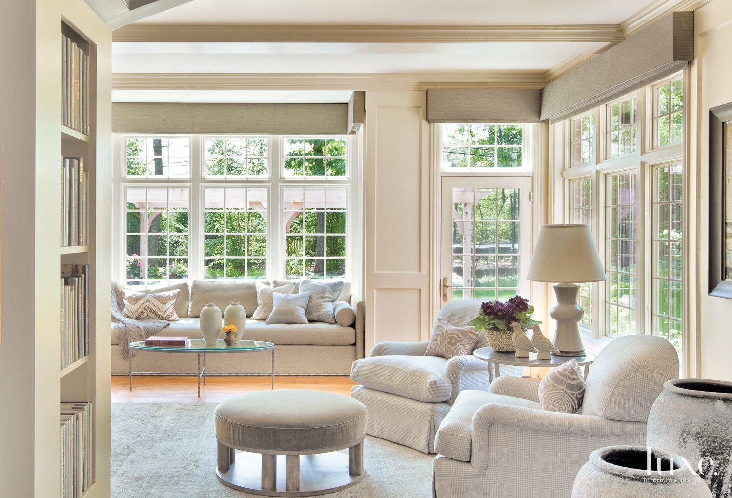 Transitional Cream Family Room with French Windows