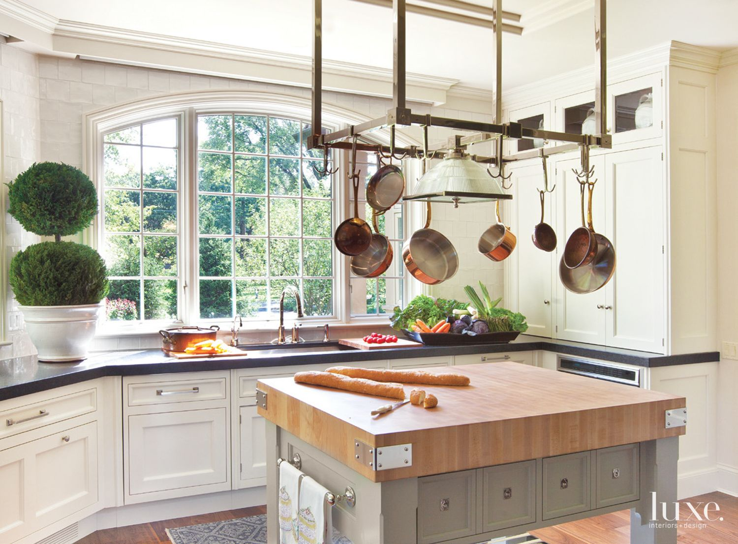 Transitional White Kitchen with Butcher Block Island