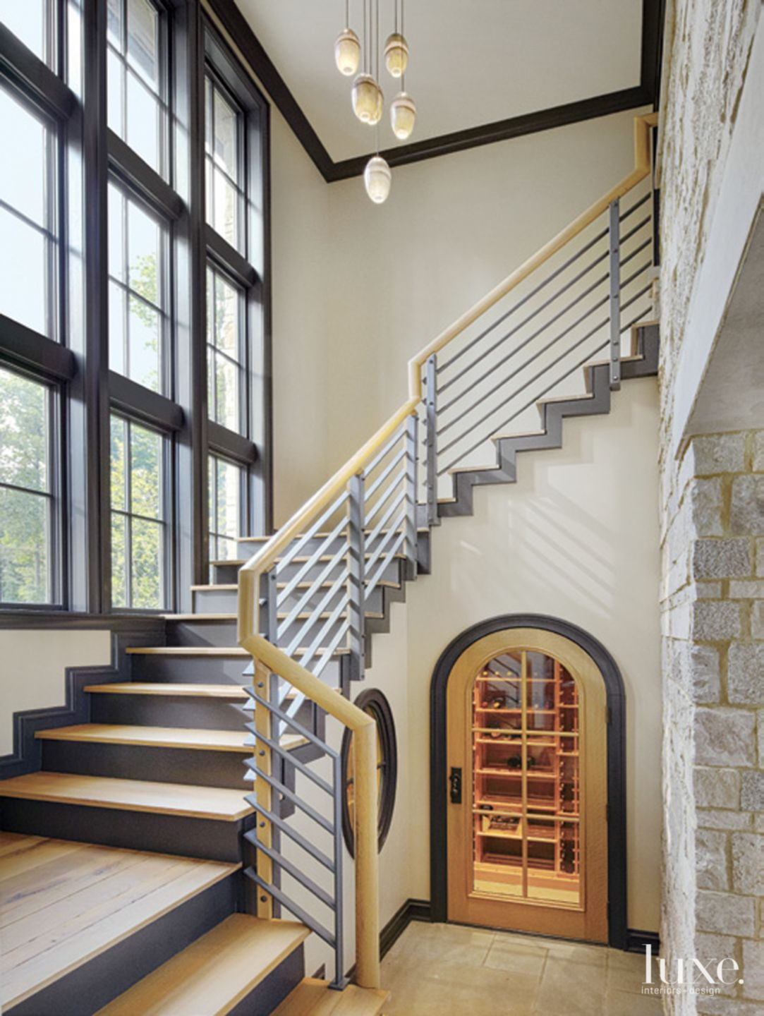 Transitional Cream Stairway with Hanging Pendants