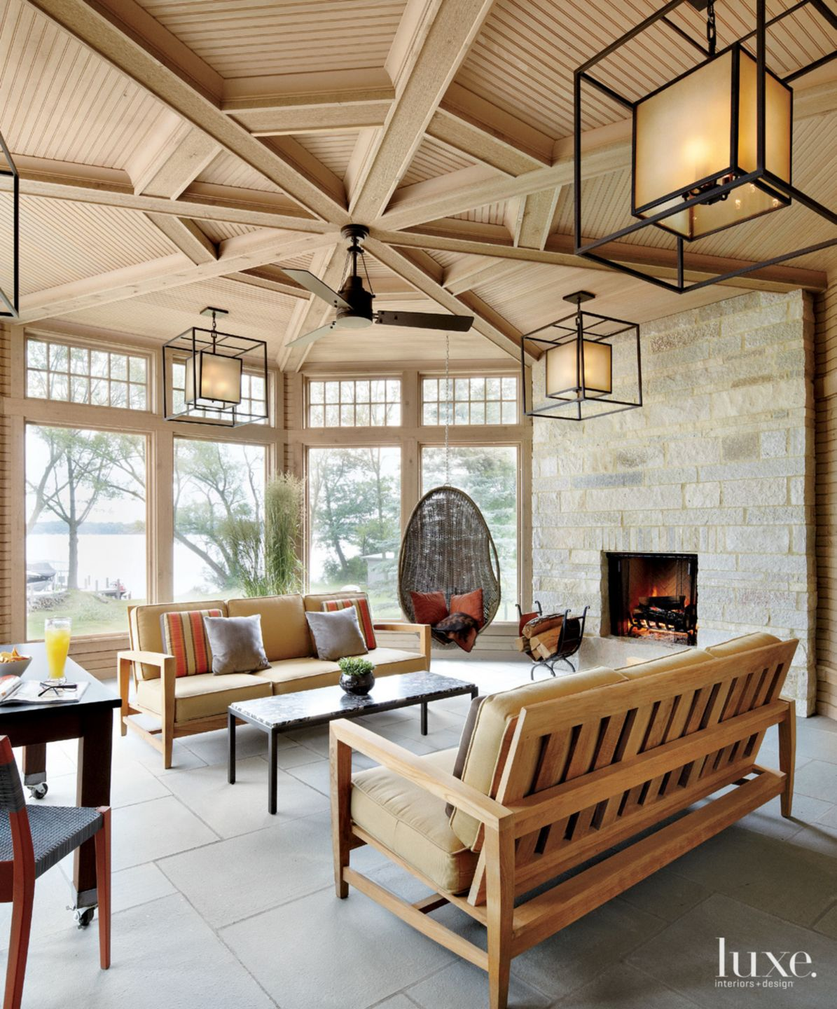 Contemporary Neutral Screened Porch with Fireplace