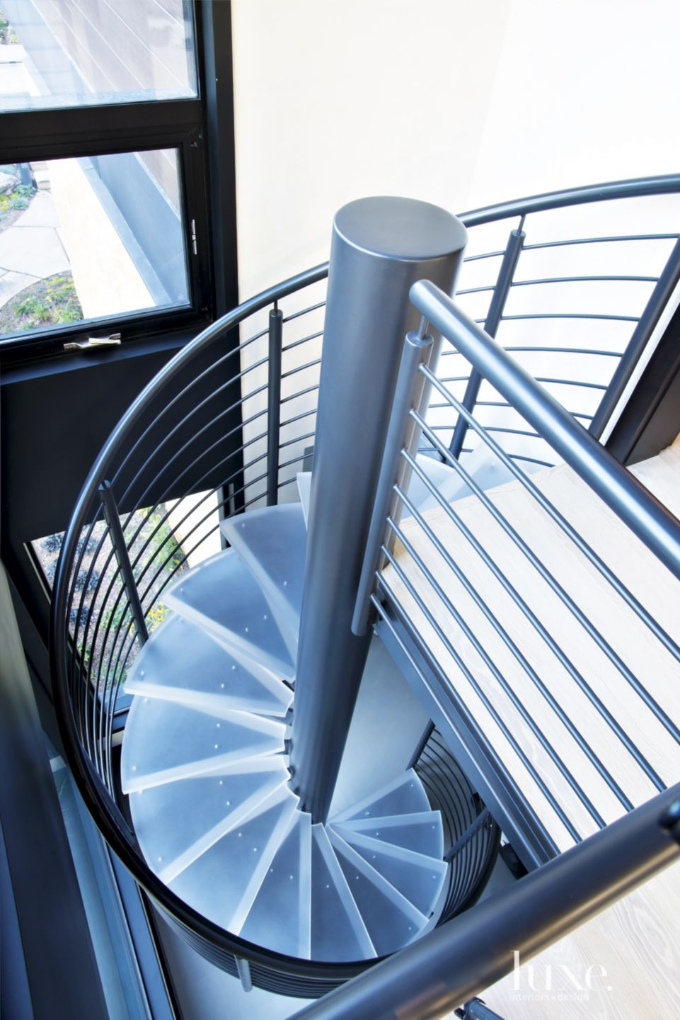 Contemporary Neutral Spiral Stairs with Metal Steps