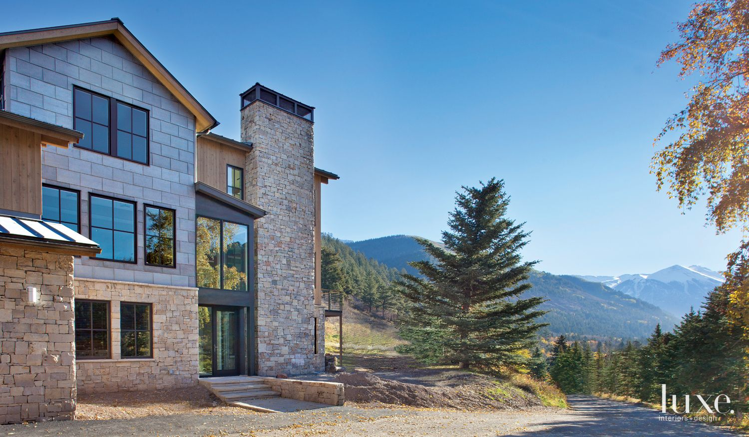 Contemporary Cedar-Clad Mountain Exterior with Mountain and Forest Vistas