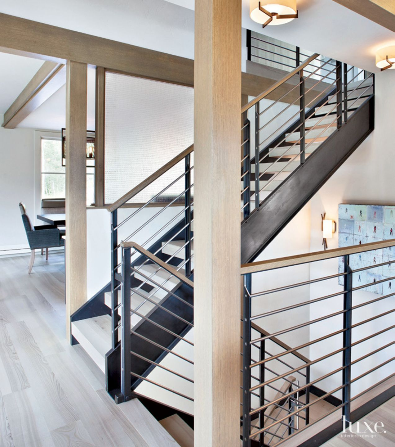 Contemporary Cream Stairwell with Steel Elements