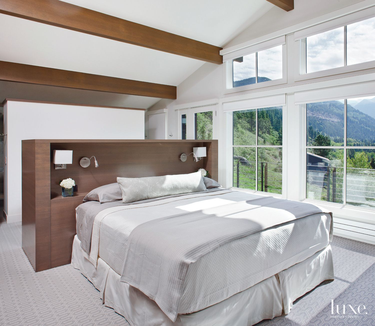 Contemporary White Master Bedroom with Freestanding Bed