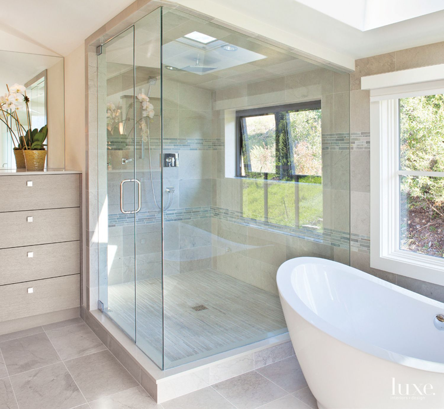 Contemporary White Master Bathroom with Skylight