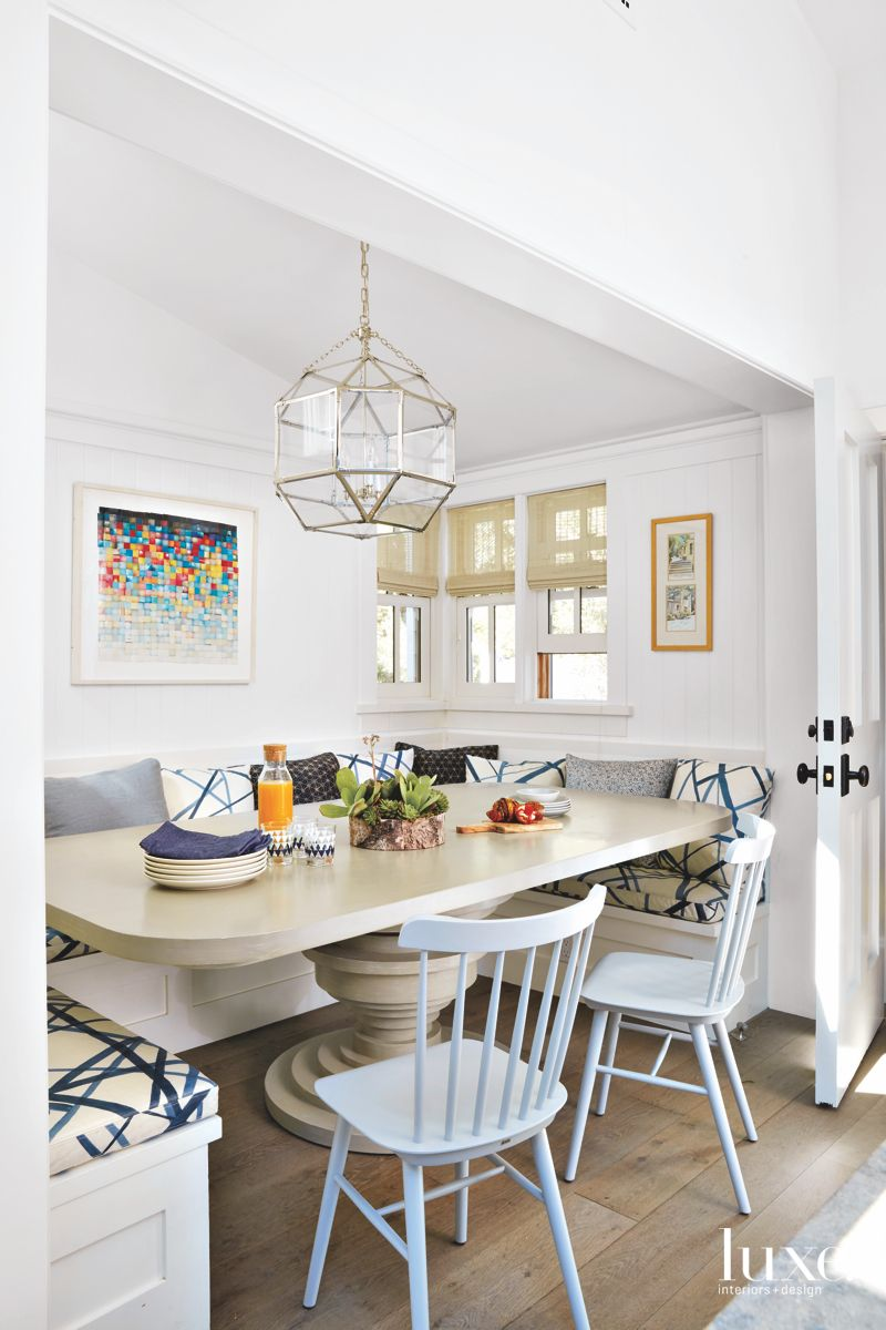 Patterned Banquette Breakfast Area with Chandelier and Art