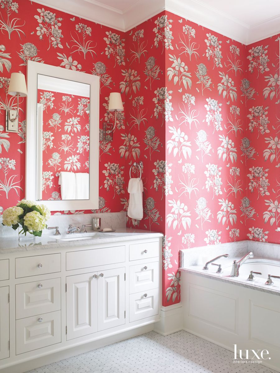 Vibrant Red Floral Wallpaper with Mirror and Soaking Tub