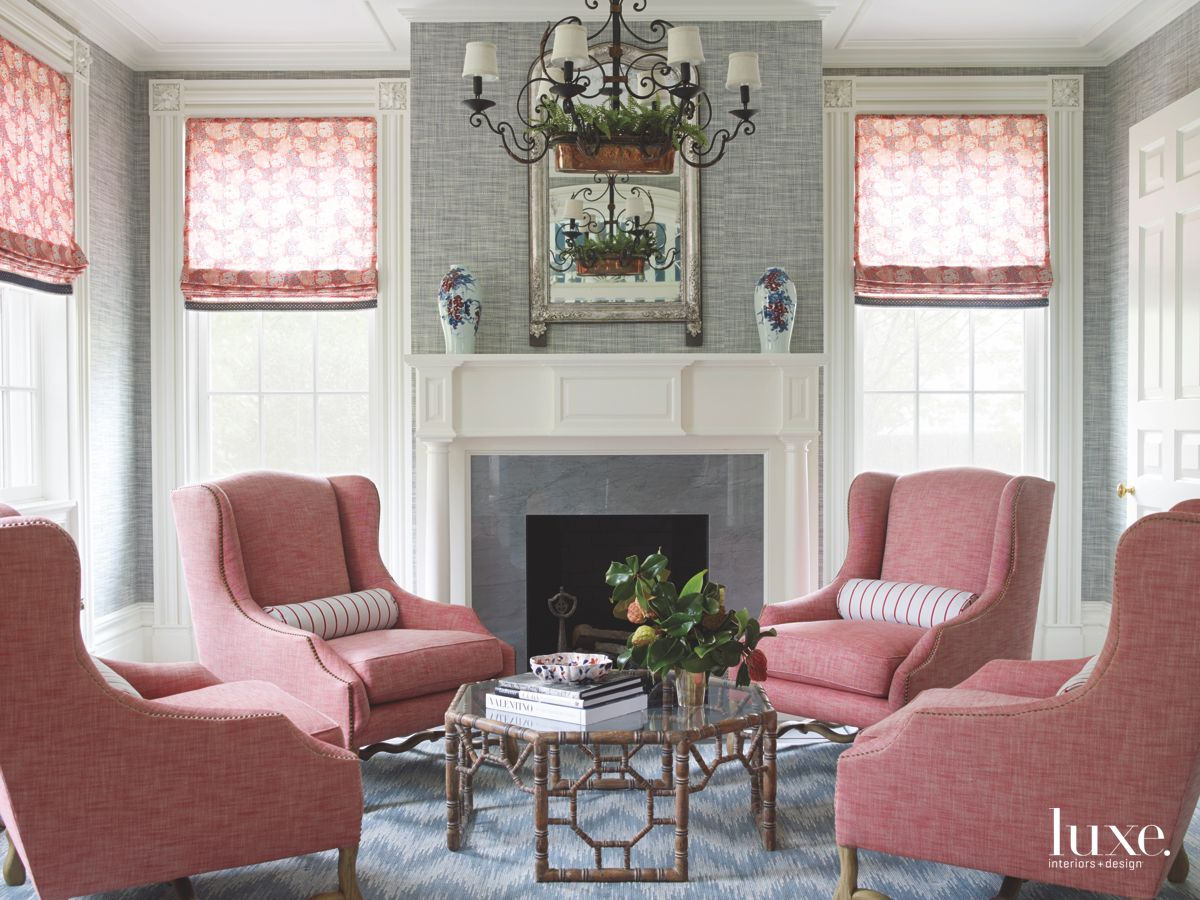 Pink Wing Chair Living Room with Fireplace and Chandelier