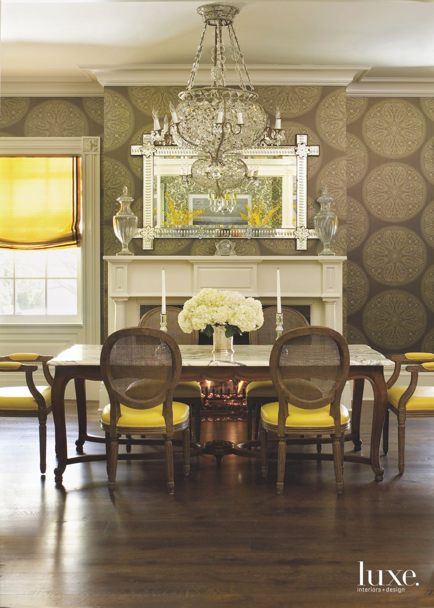 Original Fireplace Formal Dining Room with Dark Circular Wallpaper Mirror and Chandelier
