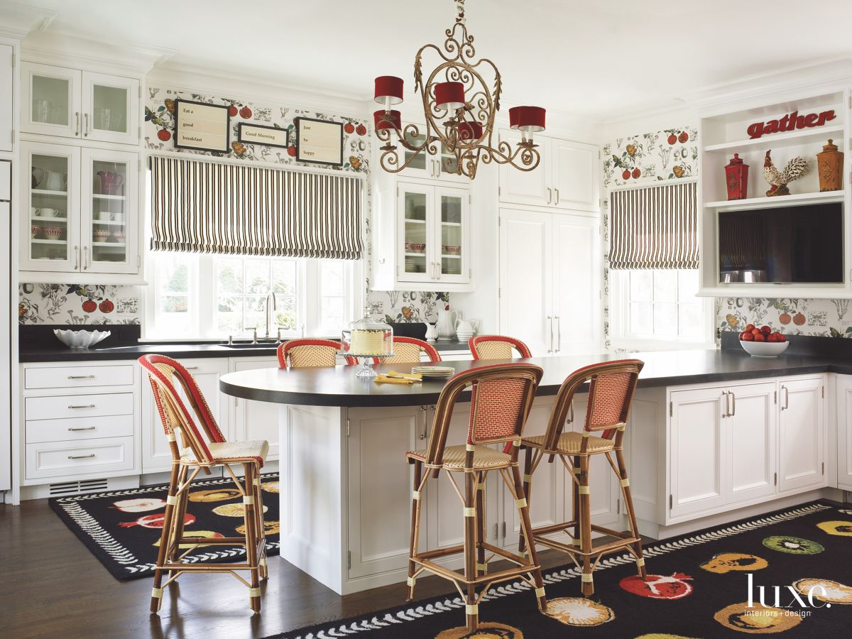 Custom Contrast Kitchen with White Cabinets, Dark Floor, Antique Chairs and Red Chandelier