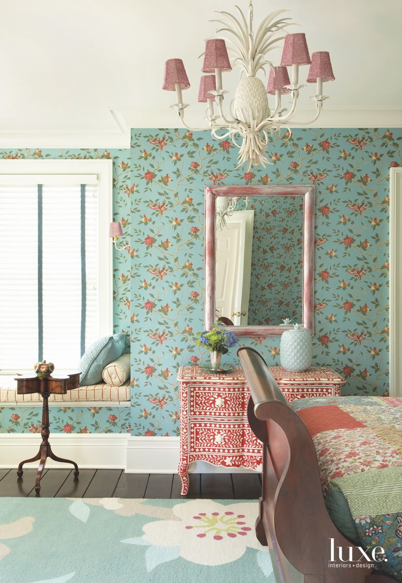Turquoise Wallpaper Guest Bedroom with Pink Accented Pineapple Chandelier, Mirror with Window Seat