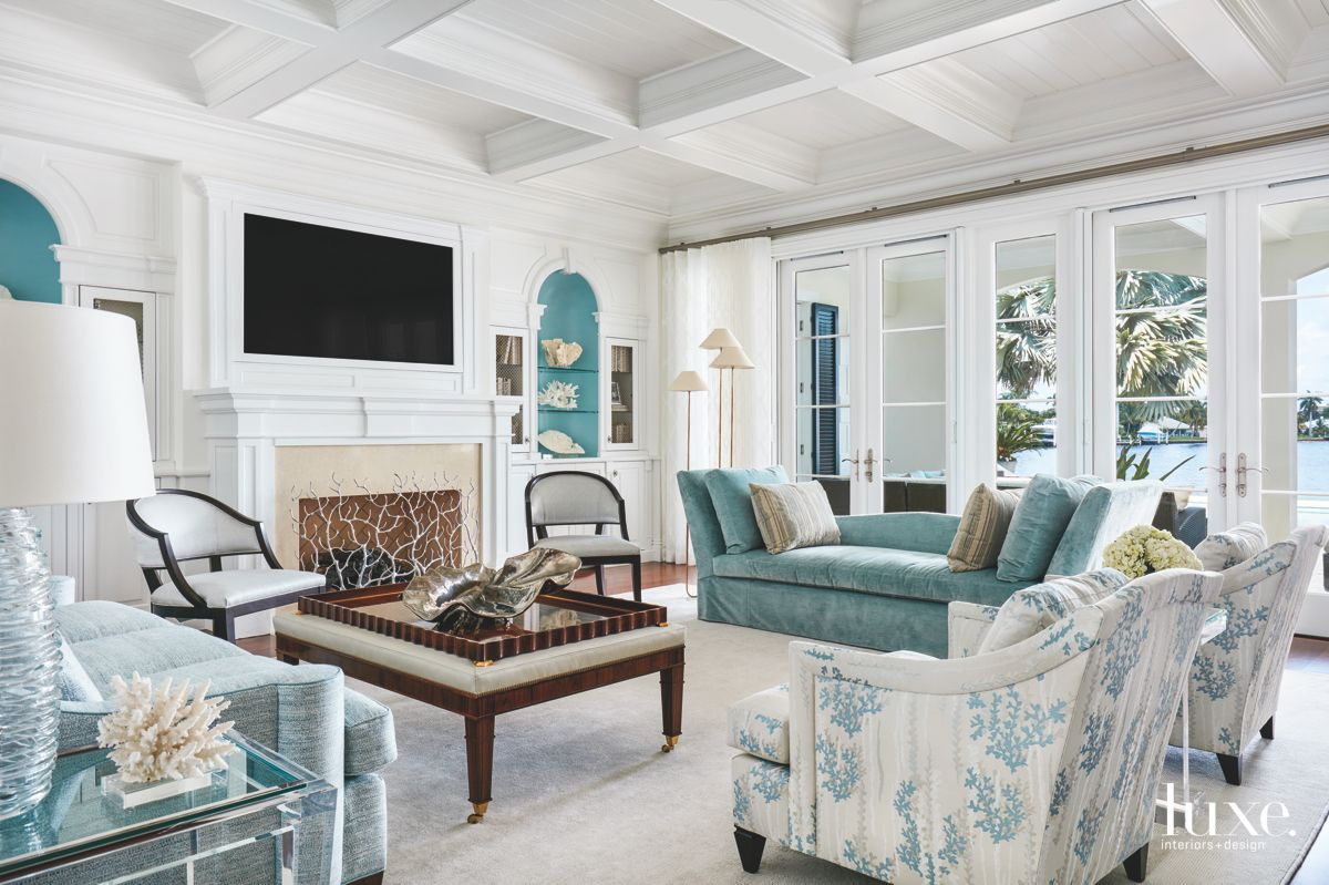 Mostly White Living Room with Blue and Coral Accents