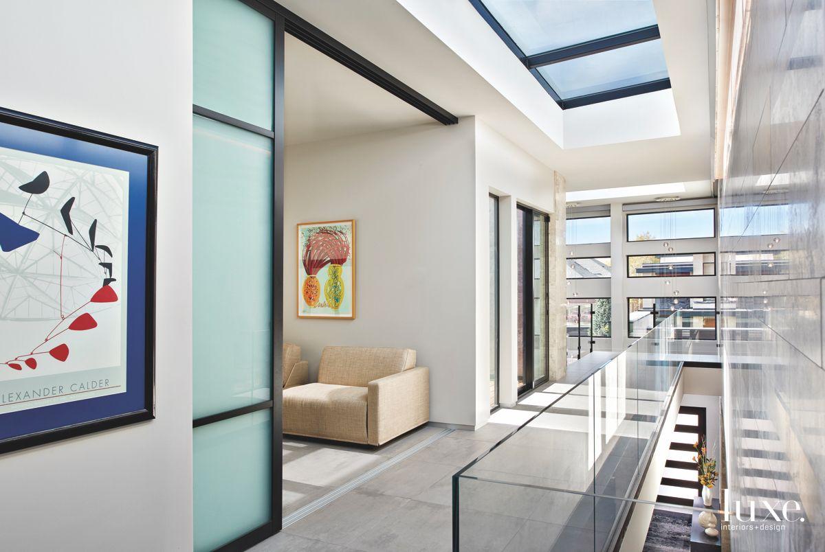 Zen Inspired Hallway with Skylights, Windows, and Artwork