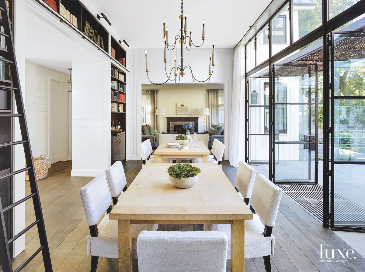 Glass and Steel Dining Room with Mini Library and Chandelier