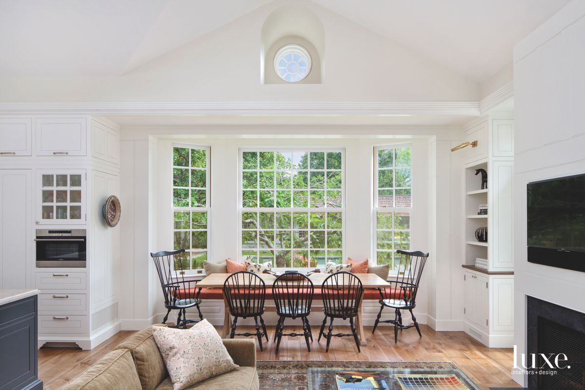 Casual Dining Area with Traditional Chairs Bay Window and High Ceiling