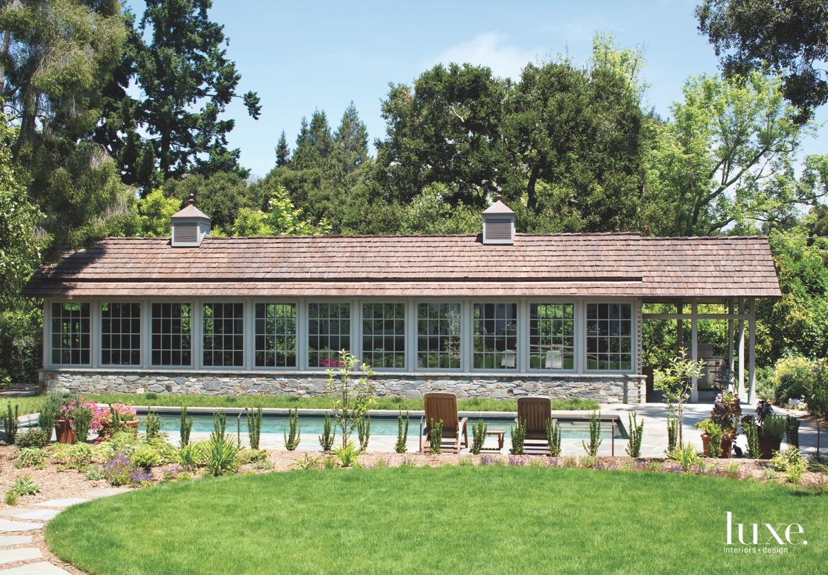 Long Glass Pane Garden Studio with Pool Lounge Chairs and Lawn