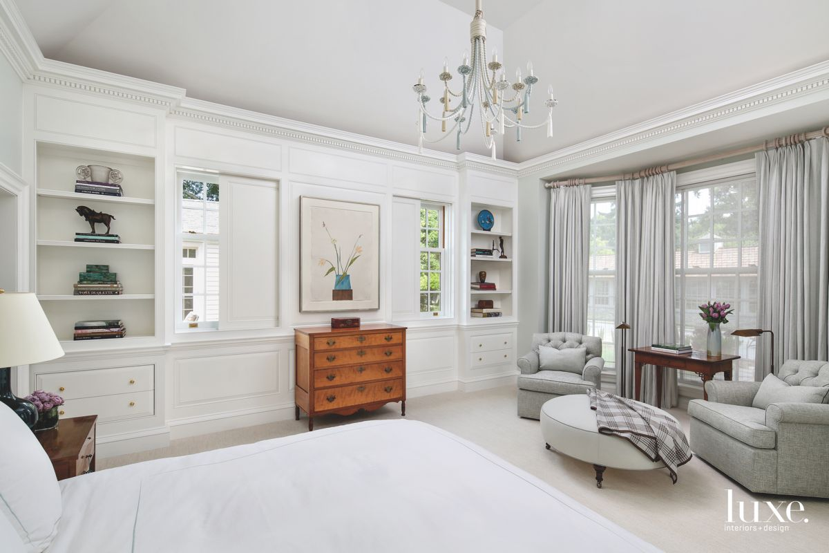 High Square Ceiling All White Master Bedroom with Artwork, Chest and Crown Moulding