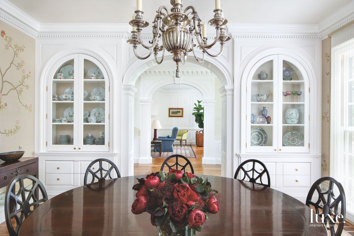 Floral Wallpaper Dining Room with China Dishware Cabinets and Chandelier