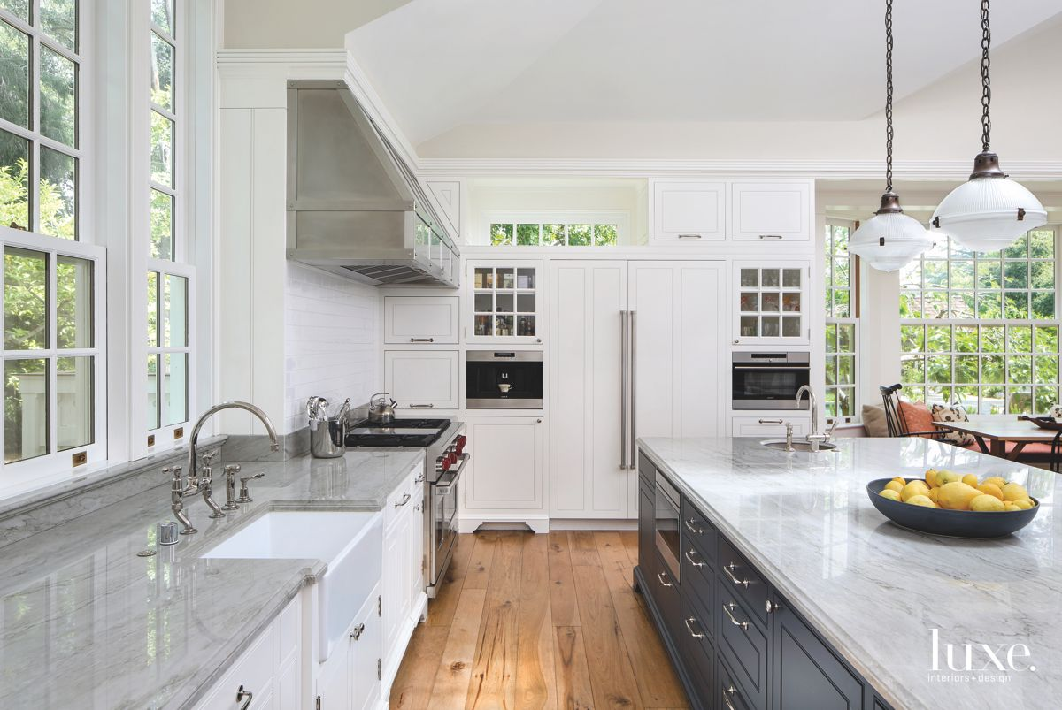 Steel Silver and White Kitchen with Pendants and Wooden Flooring and Island