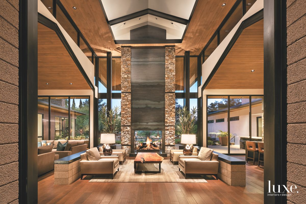 Great Room with Geometry, Fireplace, High Ceilings, and Rustic Features