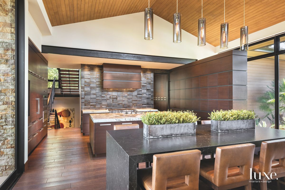 Dark Informal Dining Area that Flows into the Kitchen