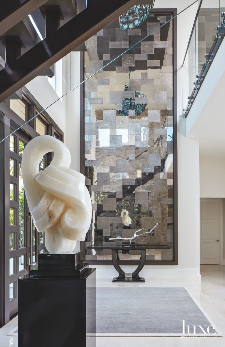 Modern Art Entryway with Marble Artwork and Geometric Abstract Artwork