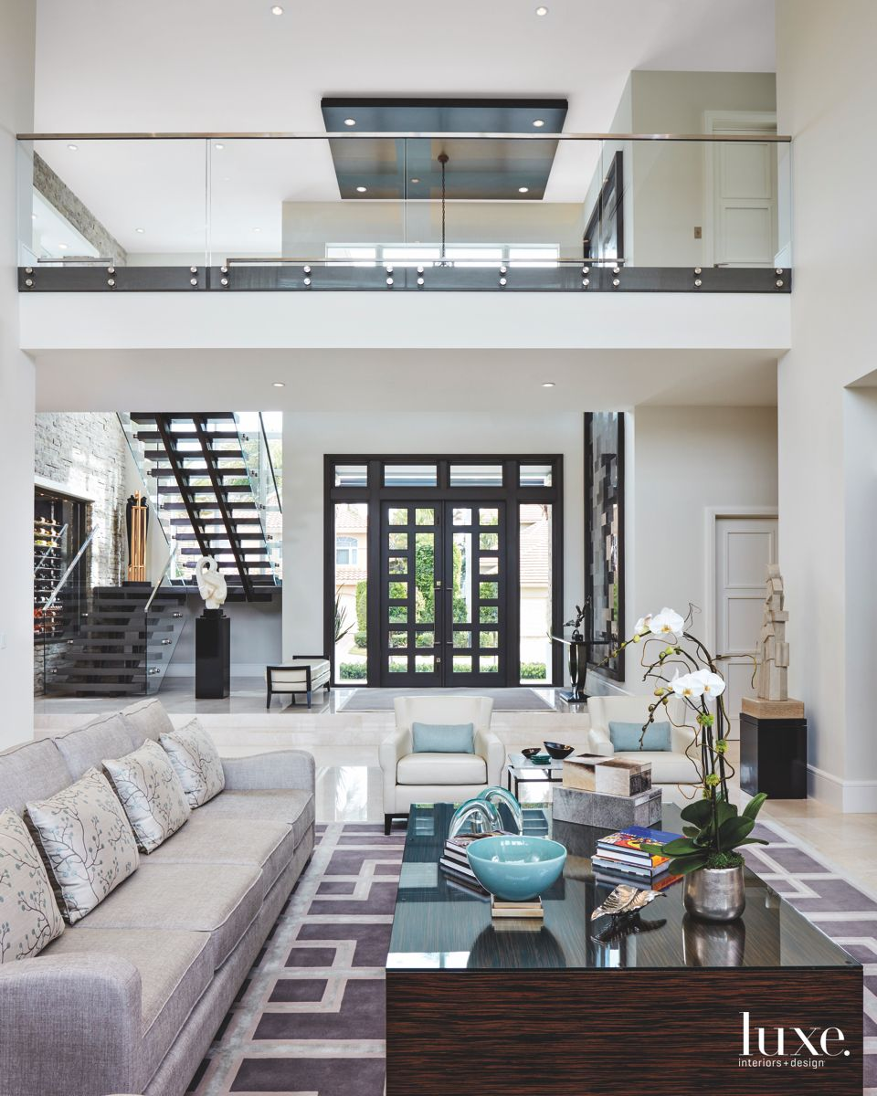 Double Height Living Room with Interior Bridge, Glass Windows, and Brown Color Scheme