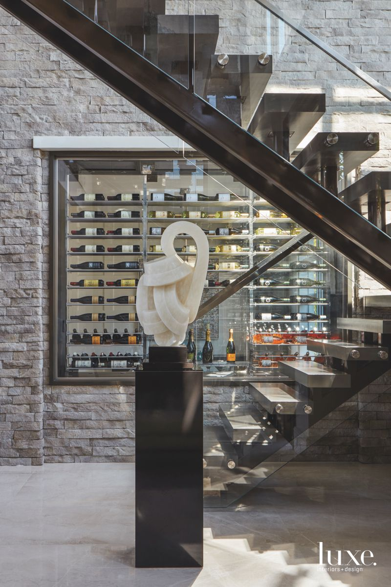 Sculpture Artwork Wine Rack Wall with Staircase and Stone Surround