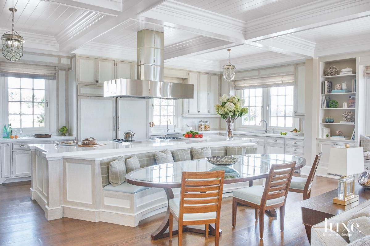 White, Gray, and Chrome Kitchen with Built-in Banquette