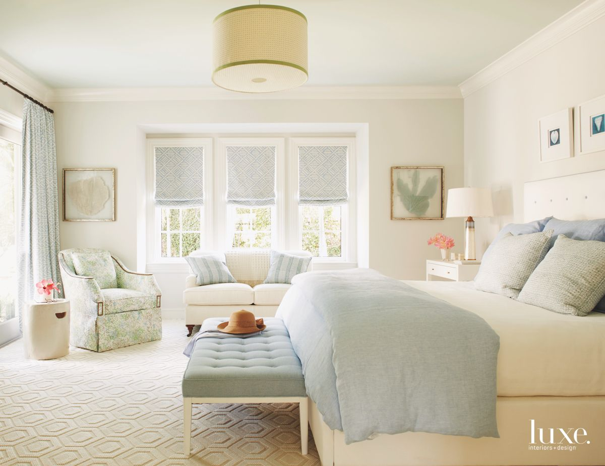 Pale Blue Master Bedroom with Bench Seating and Artwork