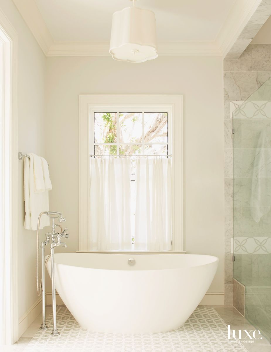 Freestanding Sculptural Tub Master Bathroom with Adjacent Shower and Patterned Tile