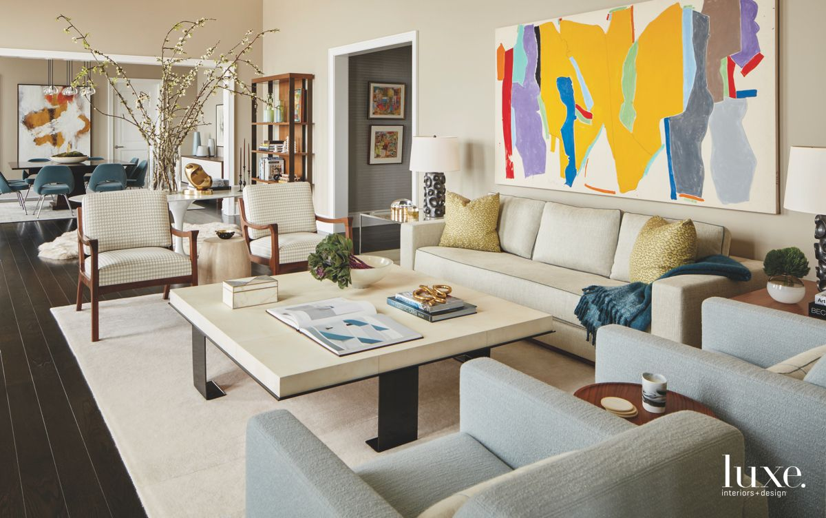 Bright Abstract Art Living Room with Sofas Surrounding a Table