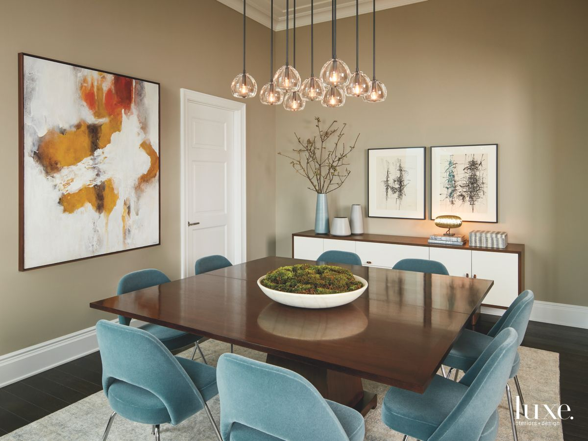 Mustard and Blue Contemporary Art Dining Room with Dangling Orb Chandelier