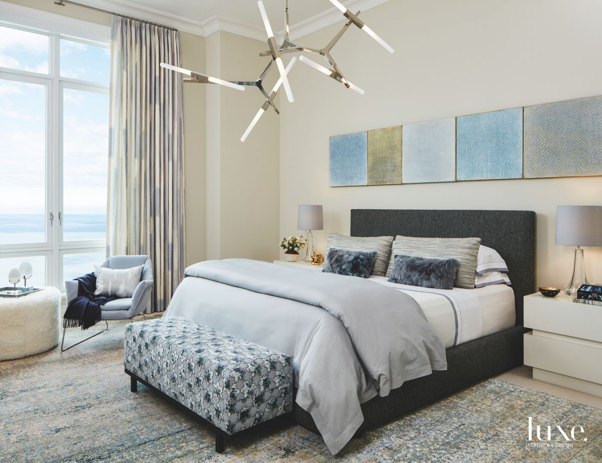 Blue Artwork Serene Master Bedroom with Abstract Lighting Fixture