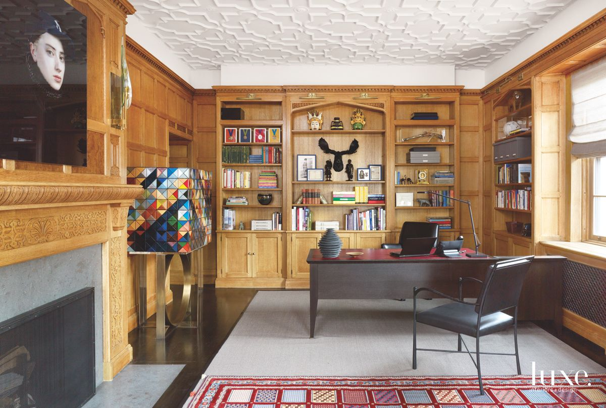 Wooden Refurbished Office with Moose Mounting and Patterned Ceiling
