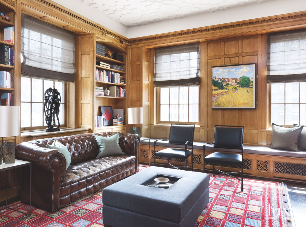 Wooden-Paneled Office with a Chesterfield Sofa and Custom Ottoman