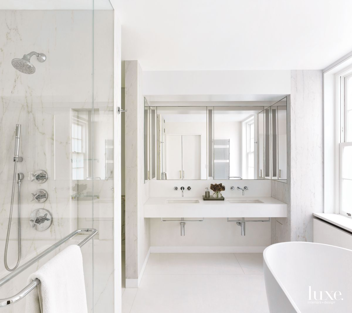Transformed All-White Master Marble Bathroom