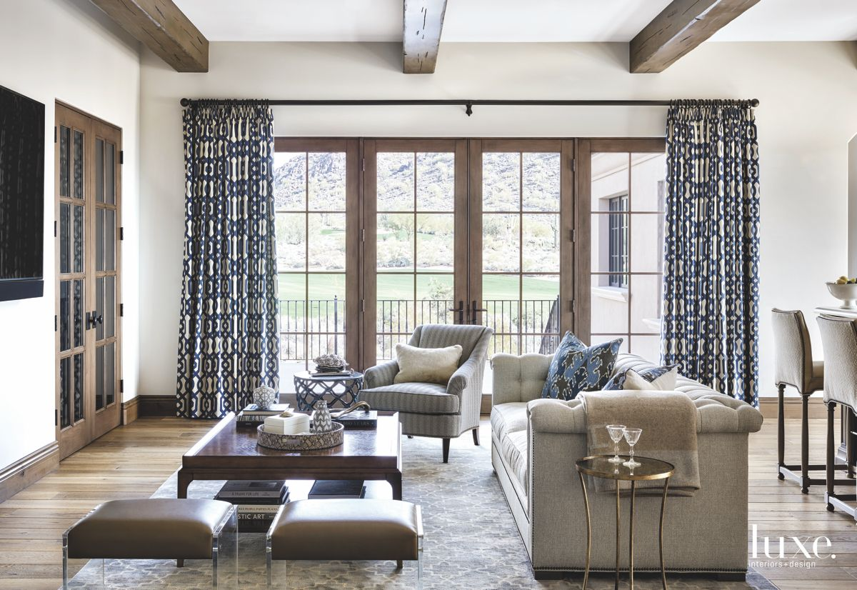 Neutral and Blue Great Room with Large Windows