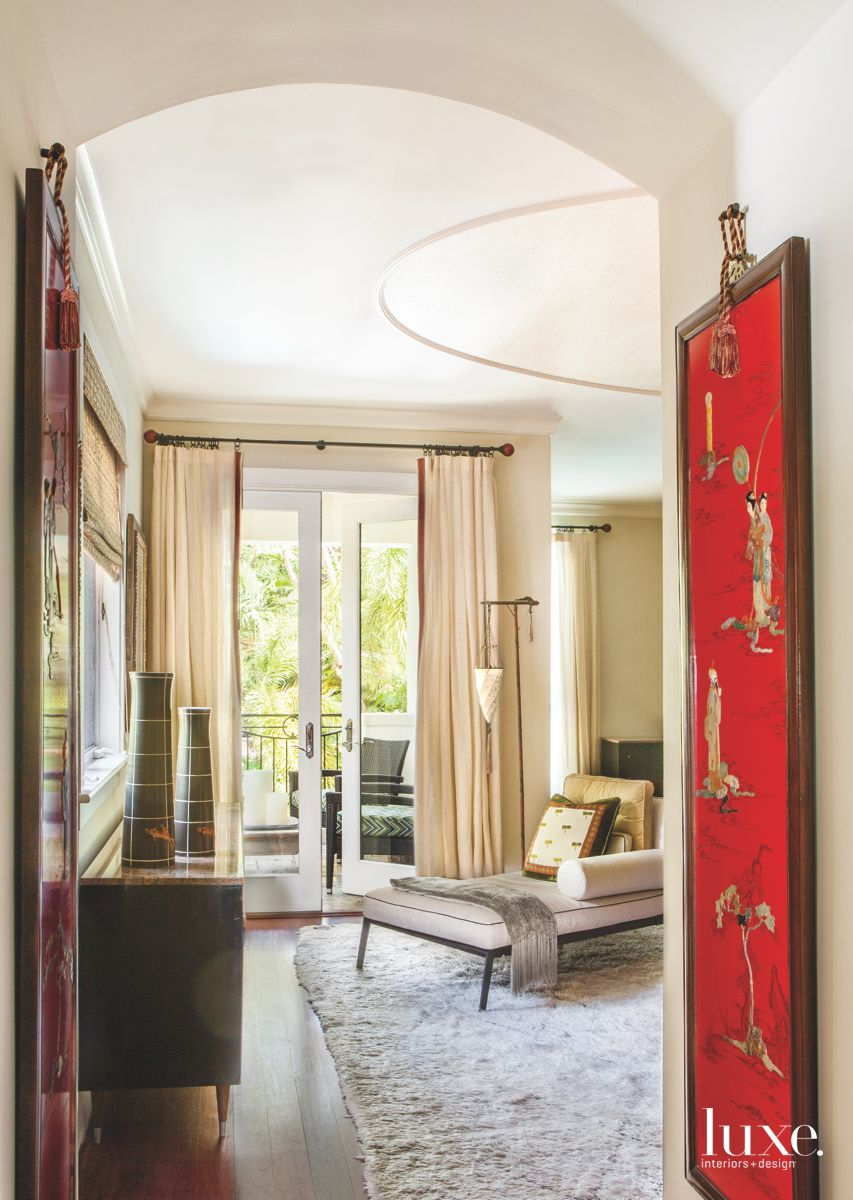 Red Asian Art Master Bedroom Entrance with Neutral Chaise